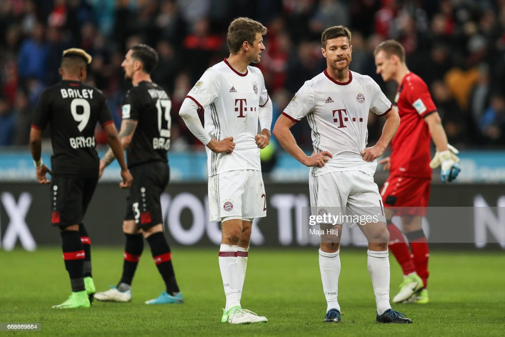 Xabi Alonso of Bayern and Thomas Mueller react after the Bundesliga match between Bayer 04 Leverkusen and Bayern Muenchen at BayArena on April 15, 2017 in Leverkusen, Germany.