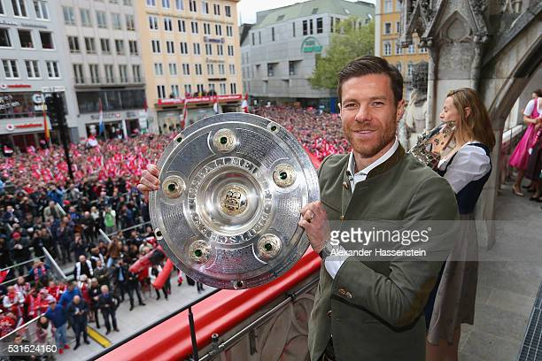 Xabi Alonso of Bayern Muenchen celebrate winning the German Championship title on the town hall balcony at Marienplatz on May 15 2016 in Munich...