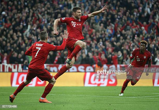 Xabi Alonso of Bayern Muenchen celebrates his first goal with teammates Franck Ribery and David Alaba during the Champions League semi final second...