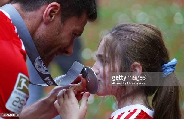 Xabi Alonso of Bayern Muenchen celebrates with his daughter following the Bundesliga match between Bayern Muenchen and SC Freiburg at Allianz Arena...