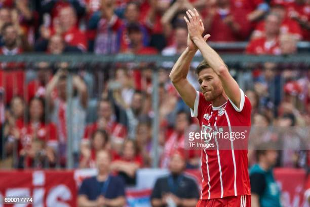 Xabi Alonso of Bayern Muenchen gestures during the Bundesliga match between Bayern Muenchen and SCon Freiburg at Allianz Arena on May 20 2017 in...