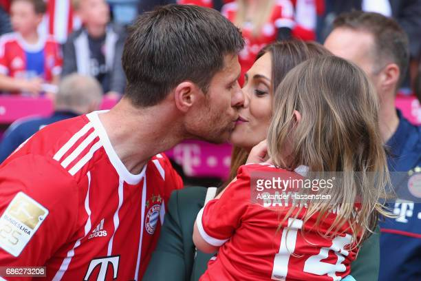 Xabi Alonso of Bayern Muenchen kisses his wife Nagore Aramburu after the Bundesliga match between Bayern Muenchen and SC Freiburg at Allianz Arena on...