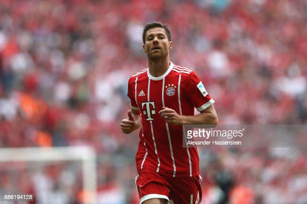 Xabi Alonso of Bayern Muenchen looks on uring the Bundesliga match between Bayern Muenchen and SC Freiburg at Allianz Arena on May 20 2017 in Munich...