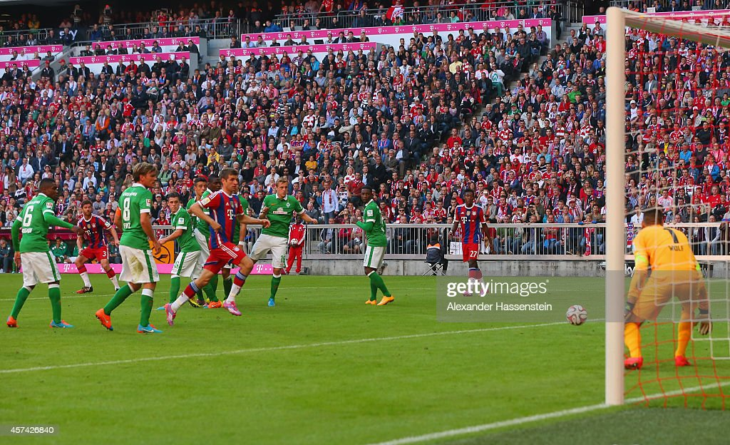 Xabi Alonso of Bayern Muenchen scores their second goal during the Bundesliga match between FC Bayern Muenchen and SV Werder Bremen at Allianz Arena on October 18, 2014 in Munich, Germany.
