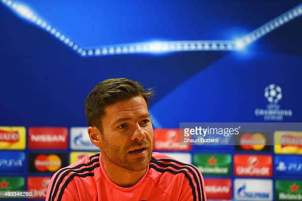 Xabi Alonso of Bayern Muenchen talks during a Bayern Munchen press conference ahead of the UEFA Champions League match against Arsenal at Emirates...