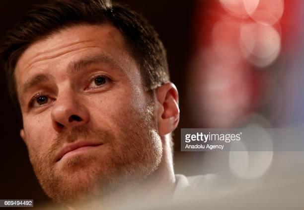 Xabi Alonso of Bayern Munich attends a press conference ahead of the Champions League quarterfinal second leg soccer match between Real Madrid and...