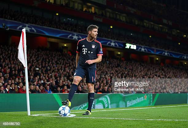 Xabi Alonso of Bayern Munich prepares to take a corner during the UEFA Champions League match between Arsenal and Bayern Munich at the Emirates...