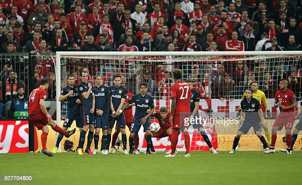 Xabi Alonso of Bayern Munich scores their first goal from a free kick during UEFA Champions League semi final second leg match between FC Bayern...