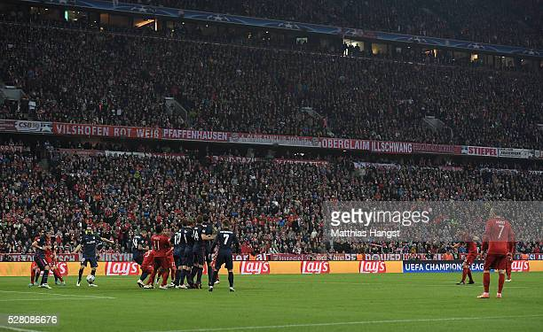 Xabi Alonso of Bayern Munich scores their first goal from a free kick during the UEFA Champions League semi final second leg match between FC Bayern...