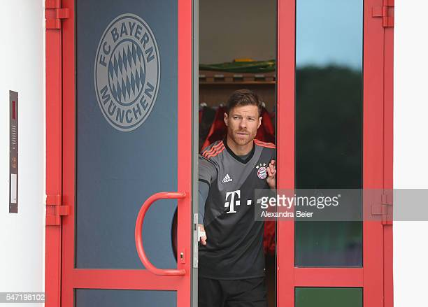 Xabi Alonso of FC Bayern Muenchen arrives for a training session wearing the new away jersey at Saebener Strasse training ground on July 14 2016 in...