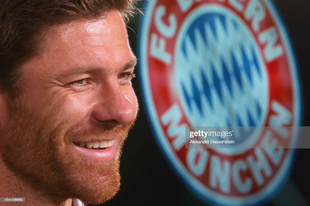 Xabi Alonso of FC Bayern Muenchen smiles during a press conference at Bayern Muenchen's headquarter Saebener Strasse on September 1, 2014 in Munich, Germany.