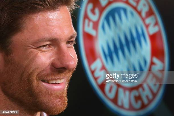 Xabi Alonso of FC Bayern Muenchen smiles during a press conference at Bayern Muenchen's headquarter Saebener Strasse on September 1 2014 in Munich...