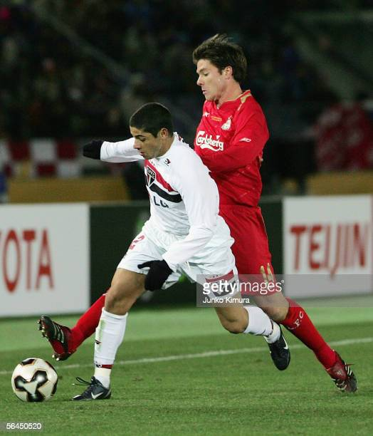 Xabi Alonso of Liverpool and Cicinho of Sao Paulo battle for the ball during the FIFA Club World Championship Toyota Cup 2005 match between Sao Paulo...