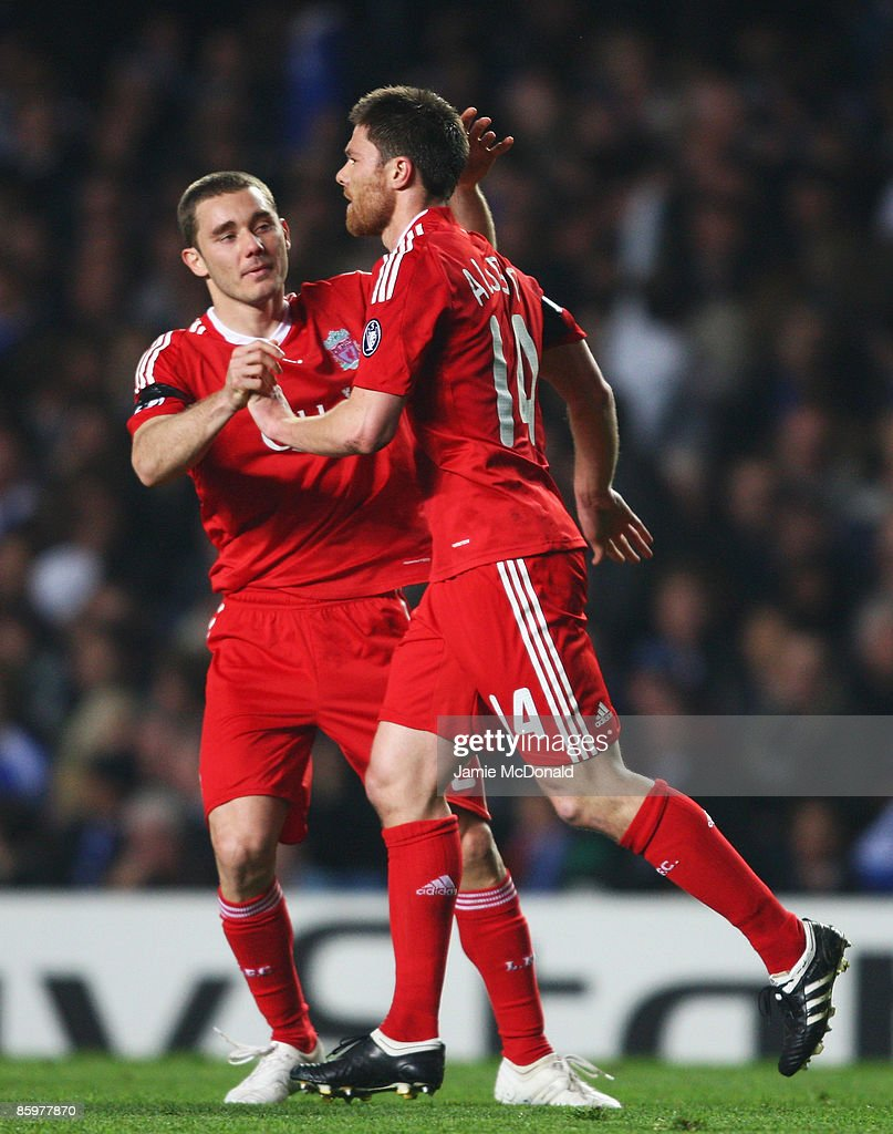 Xabi Alonso (R) of Liverpool celebrates his goal with team mate Fabio Aurelio during the UEFA Champions League Quarter Final Second Leg match between Chelsea and Liverpool at Stamford Bridge on April 14, 2009 in London, England.