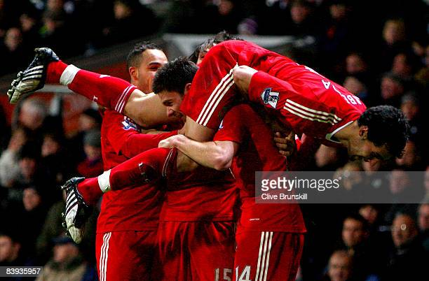 Xabi Alonso of Liverpool celebrates scoring the first goal with team mates Nabil El Zhar Yossi Benayoun and Alvaro Arbeloa during the Barclays...