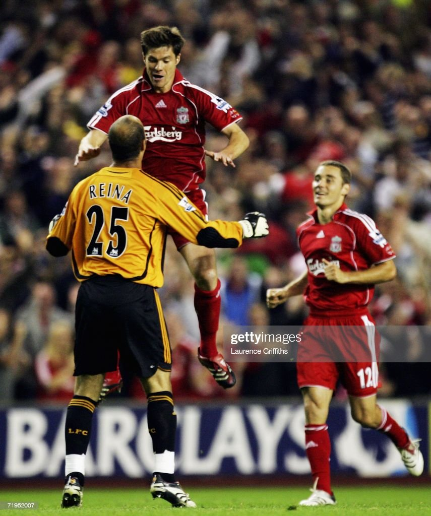 Xabi Alonso of Liverpool celebrates with his teammates goalkeeper Jose Reina and Fabio Aurelio after he scored during the Barclays Premiership match between Liverpool and Newcastle United at Anfield on September 20, 2006 in Liverpool, England.