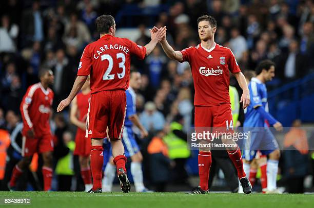 Xabi Alonso of Liverpool celebrates with Jamie Carragher of Liverpool after they beat Chelsea at home during the Barclays Premier League match...