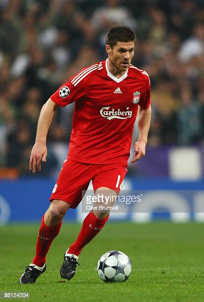 Xabi Alonso of Liverpool in action during the Champions League Round of 16 First Leg match between Real Madrid and Liverpool at the Estadio Santiago...