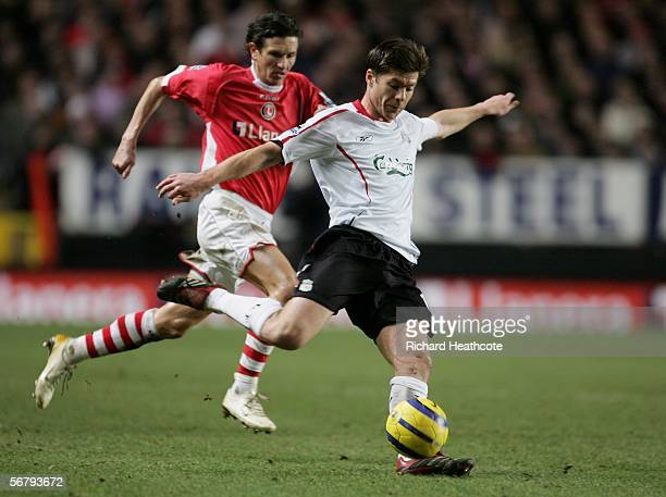Xabi Alonso of Liverpool passes the ball upfield away from Alexei Smertin of Charlton Athletic during the Barclays Premiership match between Charlton...