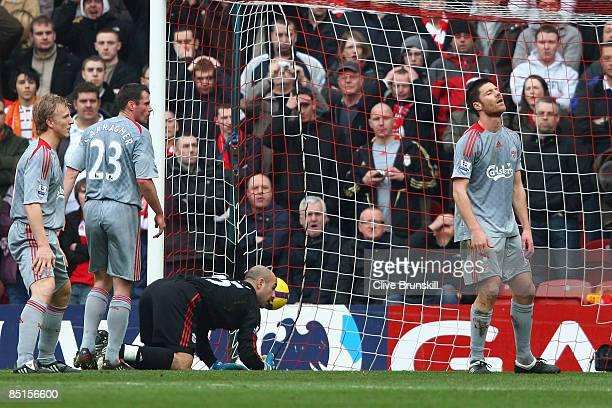 Xabi Alonso of Liverpool reacts after scoring an own goal during the Barclays Premier League match between Middlesbrough and Liverpool at the...