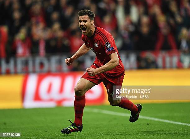Xabi Alonso of Muenchen celebrates scoring his goal during the UEFA Champions League Semi Final second leg match between FC Bayern Muenchen and Club...