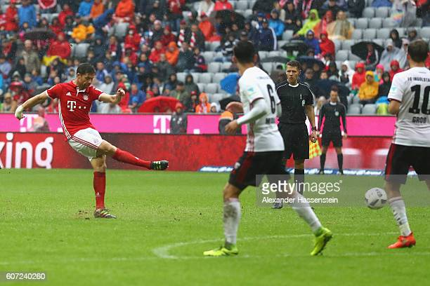 Xabi Alonso of Muenchen scores the 2nd team goal during the Bundesliga match between Bayern Muenchen and FC Ingolstadt 04 at Allianz Arena on...