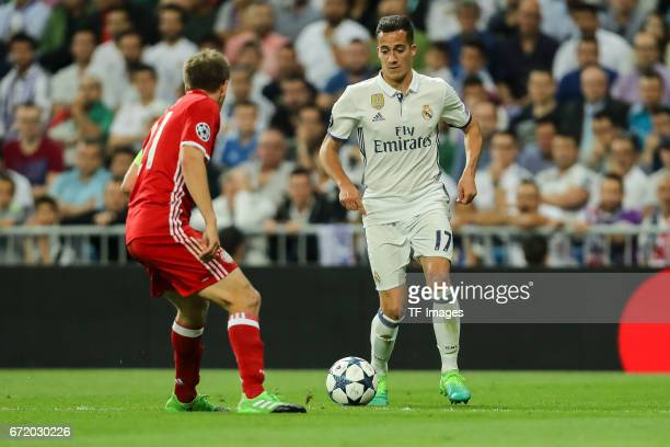 Xabi Alonso of Munich and Lucas Vazquez of Real Madrid battle for the ball during the UEFA Champions League Quarter Final second leg match between...
