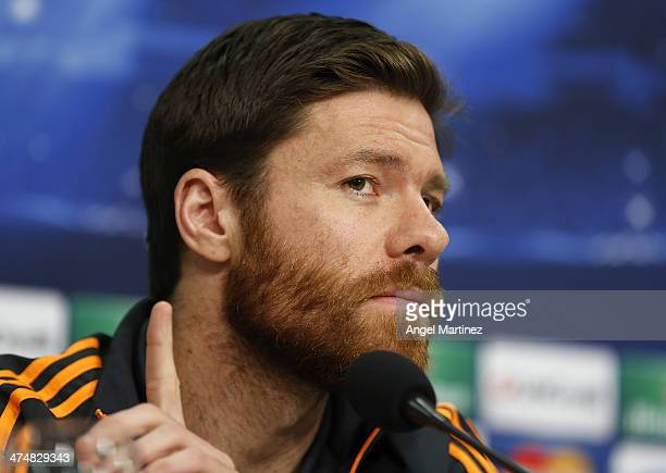 Xabi Alonso of Real Madrid attends a press conference ahead of their UEFA Champions League Round of 16 first leg match against FC Schalke 04 at...