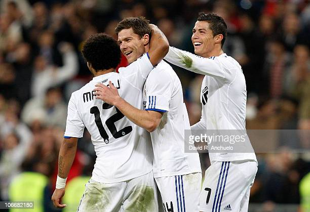 Xabi Alonso of Real Madrid celebrates after scoring with Marcelo Vieria and Cristiano Ronaldo during the Copa del Rey match between Real Madrid and...