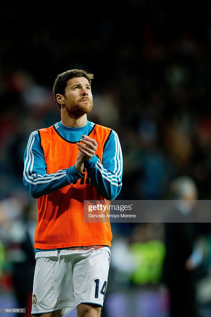 Xabi Alonso of Real Madrid CF celebrates their third goal during his warm-up before entering the pitch as a substitute during the La Liga match between Real Madrid CF and RCD Mallorca at Santiago Bernabeu Stadium on March 16, 2013 in Madrid, Spain.