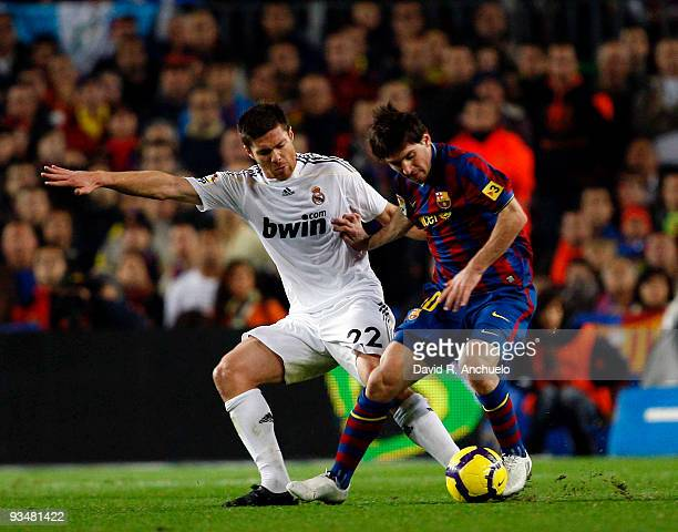 Xabi Alonso of Real Madrid fights for the ball during the La Liga match between Barcelona and Real Madrid at Nou Camp on November 29 2009 in...