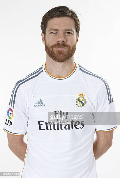 Xabi Alonso of Real Madrid poses during the official team photo session at Valdebebas training ground on September 13 2013 in Madrid Spain