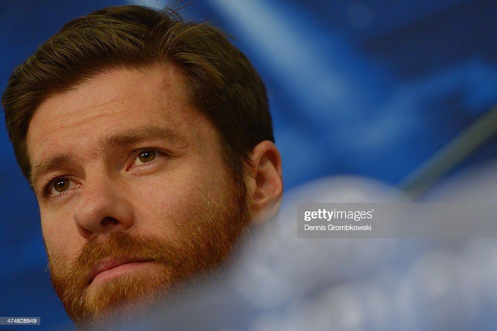Xabi Alonso of Real Madrid reacts during a press conference ahead of the Champions League match between FC Schalke 04 and Real Madrid at Veltins-Arena on February 25, 2014 in Gelsenkirchen, Germany.