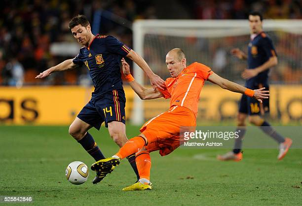 Xabi Alonso of Spain and Arjen Robben of Netherlands