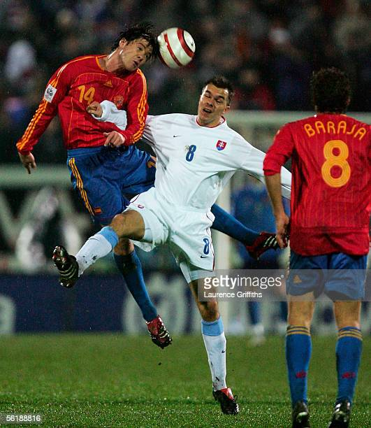 Xabi Alonso of Spain battles with Szilard Nemeth of Slovakia during the FIFA 2006 World Cup Playoff match between Slovakia and Spain on November 16...