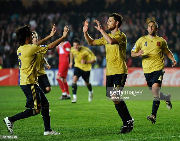 Xabi Alonso of Spain celebrates after scoring the equalizer with his teammate David Silva during the FIFA2010 World Cup Qualifier between Turkey and...