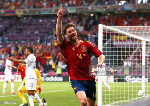 Xabi Alonso of Spain celebrates after scoring the first goal during the UEFA EURO 2012 quarter final match between Spain and France at Donbass Arena...