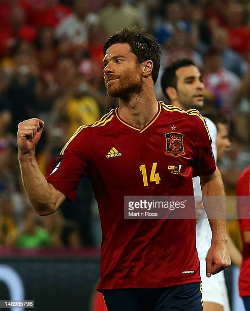 Xabi Alonso of Spain celebrates after scoring the second goal from the penalty spot during the UEFA EURO 2012 quarter final match between Spain and...