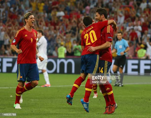 Xabi Alonso of Spain celebrates after scoring the second goal with Santi Cazorla and Fernando Torres during the UEFA EURO 2012 quarter final match...