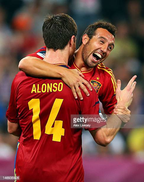 Xabi Alonso of Spain celebrates after scoring the second goal with Santi Cazorla during the UEFA EURO 2012 quarter final match between Spain and...