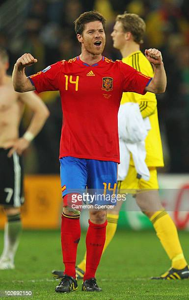 Xabi Alonso of Spain celebrates victory and a place in the final during the 2010 FIFA World Cup South Africa Semi Final match between Germany and...