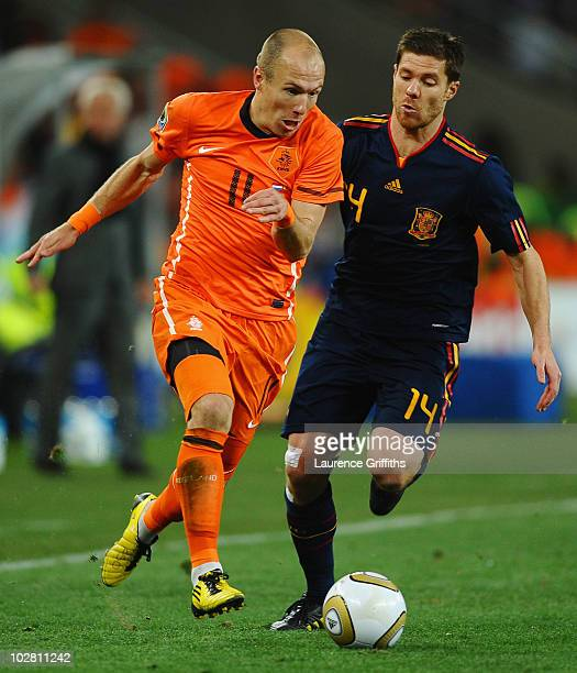 Xabi Alonso of Spain challenges Arjen Robben of the Netherlands during the 2010 FIFA World Cup South Africa Final match between Netherlands and Spain...