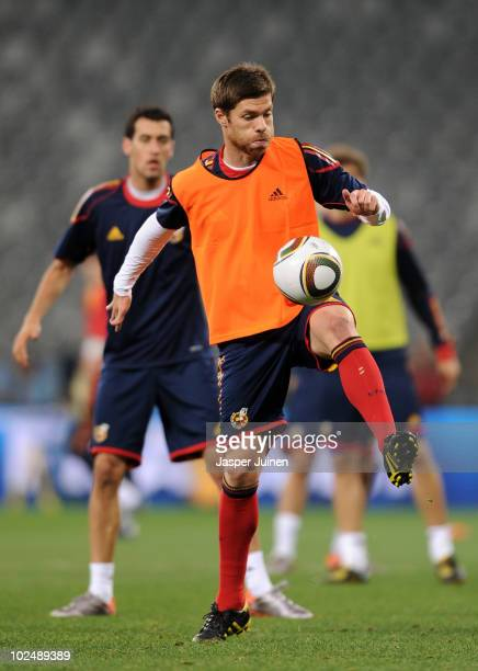 Xabi Alonso of Spain controls a ball during a training session, ahead of their 2010 World Cup Stage 2 Round of 16 match against Portugal, at the...