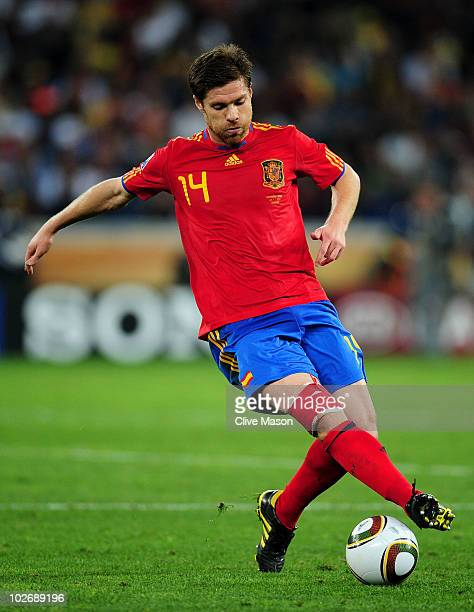 Xabi Alonso of Spain controls the ball during the 2010 FIFA World Cup South Africa Semi Final match between Germany and Spain at Durban Stadium on...