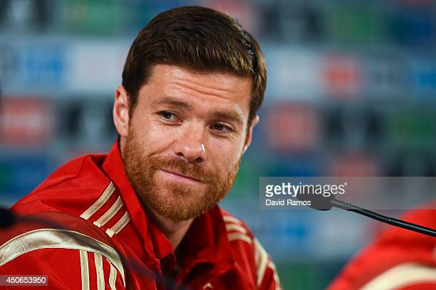 Xabi Alonso of Spain faces the media during a Spain press conference at Centro de Entrenamiento do Caju on June 15 2014 in Curitiba Brazil
