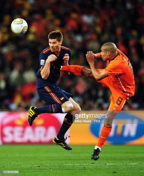 Xabi Alonso of Spain is fouled by Nigel De Jong of the Netherlands during the 2010 FIFA World Cup South Africa Final match between Netherlands and...