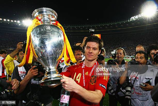 Xabi Alonso of Spain lifts the trophy after winning against Germany in the UEFA EURO 2008 Final match between Germany and Spain at Ernst Happel...