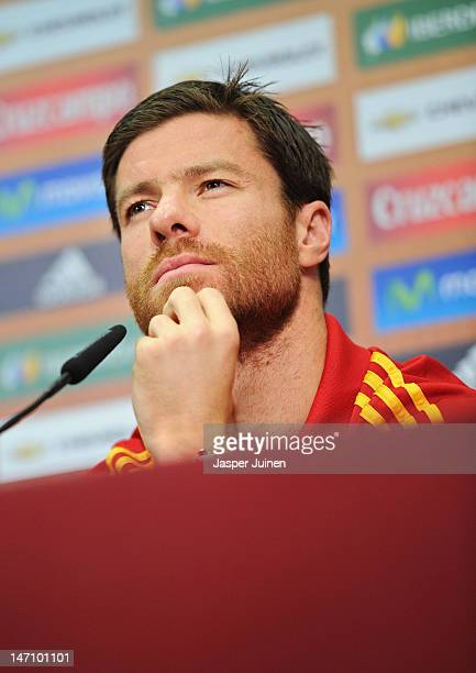 Xabi Alonso of Spain listens to questions from the media during a press conference ahead of the UEFA EURO 2012 semi-final match against Portugal on...