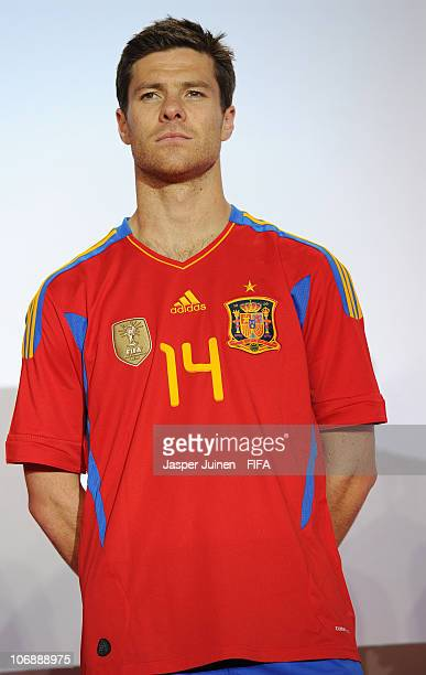 Xabi Alonso of Spain poses in Spain's new national team football shirt during the official FIFA World Champions badge handover ceremony on November...