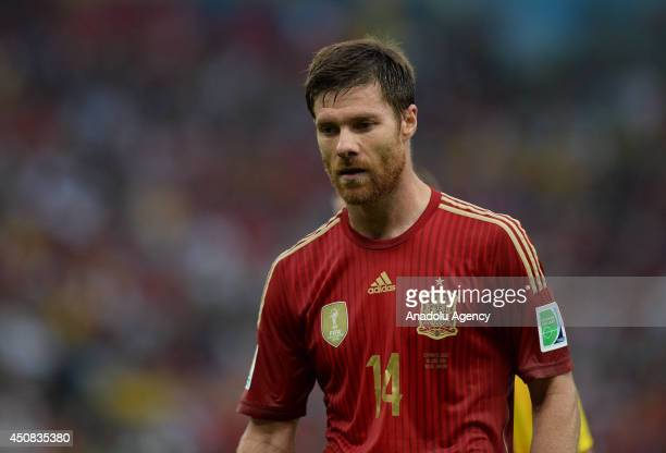 Xabi Alonso of Spain reacts after the 2014 FIFA World Cup Brazil Group B match between Spain and Chile at Estadio Maracana on June 18 2014 in Rio de...